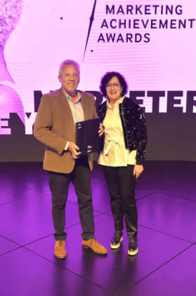Heidi Brauer CMO of Hollard presents the Marketer of the Year award Francois Viviers Executive Marketing and Communications at Capitec Bank could not attend