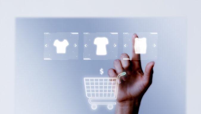 person-adding-clothes-cart-closeup-online-shopping-campaign